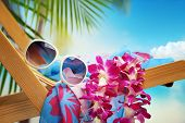 Beach accessories and flower on beach chair