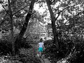 Girl Walking Through Forest
