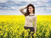 beautiful girl in yellow flower field