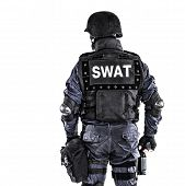 stock photo of terrorist  - Special weapons and tactics SWAT team officer shot from behind - JPG