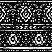 White aztec ornaments on black geometric ethnic seamless pattern, vector