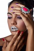 Beautiful Woman With Colorful bright Nails and Luxury Makeup with ring on tanned hands