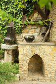 Old retro cauldrons in garden