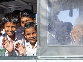 Pupils Ride In A Public Bus To School