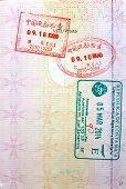 Red and green visa stamps