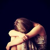 stock photo of chemise  - Young woman depression isolated on black background - JPG