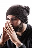 stock photo of rapper  - portrait of a thinking man with beard maybe a rapper or a gangster - JPG