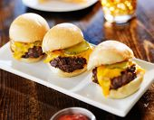 three mini burger sliders in a row