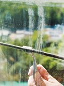Washing Of Home Window Glass By Squeegee