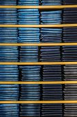 Neat stacks of folded jeans on the shop shelves