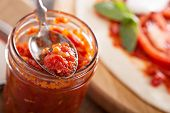 Pizza sauce in a jar selective focus