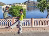 Teens Enjoy The Sunset At The Water Palace In Jaipur