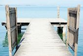 stock photo of dock a pond  - Wooden bridge on a sea dock - JPG