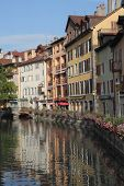 ANNECY, FRANCE - SEPTEMBER 16, 2012: The ancient city in south of France - Annecy. Homes are reflect