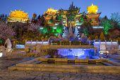 Large Prayer Wheel Near Tibetan Buildings In Shangri-la County,yunnan Province, China