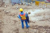 Worker At A Building Lot In Working Cloths