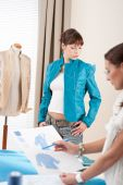 Fashion Model Trying Turquoise Jacket In Designer Studio