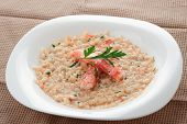 Risotto with crab meat and herbs in plate