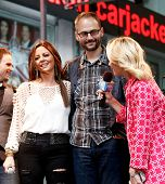 NEW YORK-MAY 23: Country music singer Sara Evans (L), brother Matt Evans (C) and Elisabeth Hasselbec