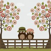 foto of bird fence  - Cute owls with tree roses on a fence - JPG