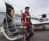Indianapolis, IN - May 25, 2014:  NASCAR driver, Kurt Busch (26), boards his Cessna Citation X for h