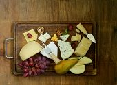 stock photo of brie cheese  - cheeseboard with assorted cheeses  - JPG