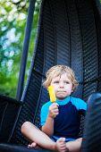 Cute Blond Boy Eating Yellow Ice Pop Cream, Outdoors