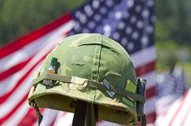 stock photo of veterans  - Vintage Vietnam era helmet at a celebration of Veterans of Foreign Wars in Sutherlin Oregon - JPG
