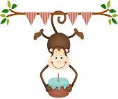 Hanging monkey holding a  birthday cake
