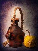 clay pot and pumpkin.Clay pot and yellow pumpkin of manual work. It is possible to store liquids