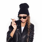 Young Woman In Sunglasses And Black Leather Jacket Smoking Cigar