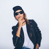 Hipster Haughty Girl In Sunglasses And Black Leather Jacket Smoking Cigar