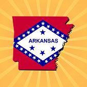 Arkansas map flag on sunburst illustration