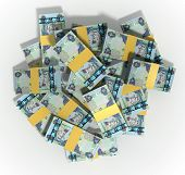 foto of dirhams  - A pile of randomly scattered wads of dirham banknotes on an isolated background - JPG