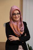 Happy Muslim Businesswoman In The Office