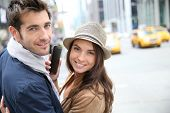 Couple in Manhattan using smartphone