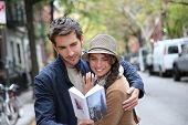 Couple with tourist guide book in Greenwich village, NYC