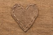 Heart  Of  Burlap, Lies On A Background Of Burlap