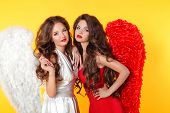 Glamorous Fashion Brunette Angel Girl With Angel's Wings. Valentine Day Women.  Isolated On Yellow B