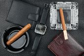 Two Ashtray With Cigars, Two Purses And Watches On The Natural Leather