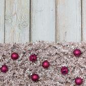 Purple Christmas Balls On Silver Tree Garland .