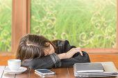 Asian Girl Sleeping While Sitting At Desk