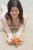 Woman looking at starfish