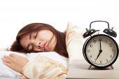 Sleeping Asian Girl With Alarm Clock