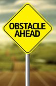 Creative sign with the message - Obstacle Ahead