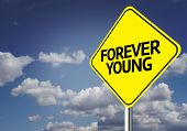 Creative sign with the message - Forever Young