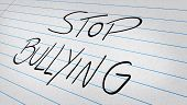 image of stop bully  - Stop Bullying written on a note pad  - JPG