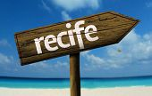 Recife, Brazil wooden sign with a beach on background
