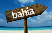 Bahia, Brazil wooden sign with a beach on background