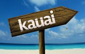 Kauai wooden sign with a beach on background